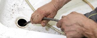 Plumber Inspecting Pipe